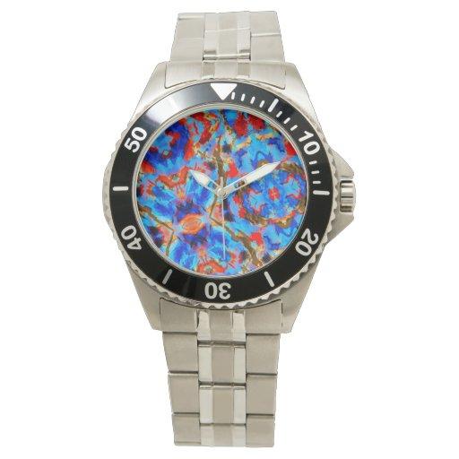 Reloj azul y anaranjado del caleidoscopio