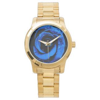 Reloj azul y de oro elegante de la mujer