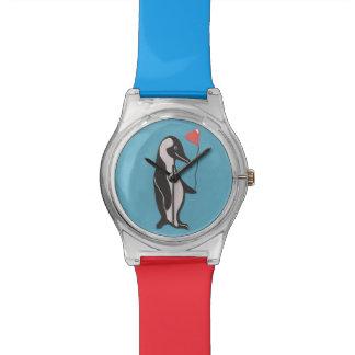 Reloj azul y rojo del pingüino