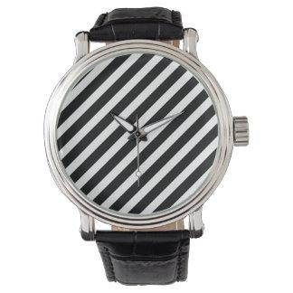 Reloj blanco y negro del vintage de las rayas