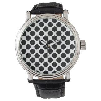 Reloj blanco y negro del vintage del lunar