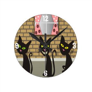 Reloj caprichoso de los gatos negros
