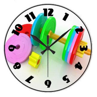 Reloj colorido de las pesas de gimnasia