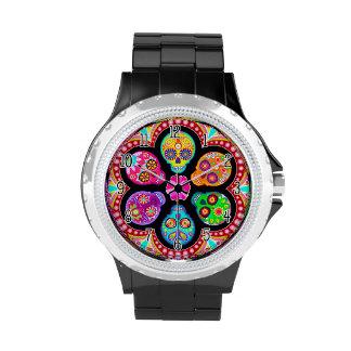 Reloj colorido de los cráneos del azúcar - día de