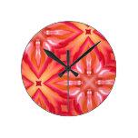 Reloj con el modelo abstracto rosado del rosa