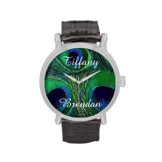 Reloj conocido doble de la pluma del pavo real del