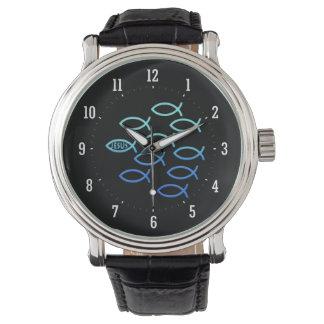 Reloj cristiano de los símbolos de los pescados