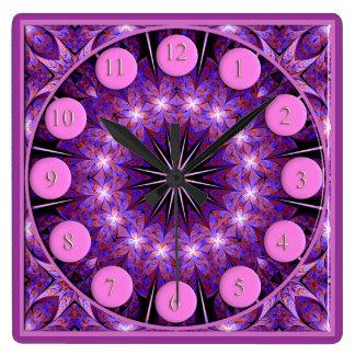 Reloj cuadrado rosado de Starburst