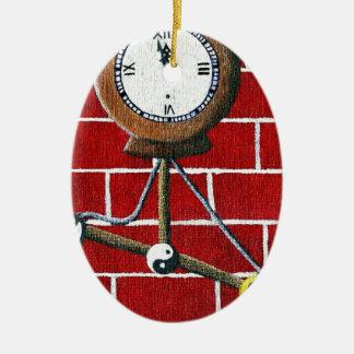 Reloj de día de las condenaciones adorno ovalado de cerámica
