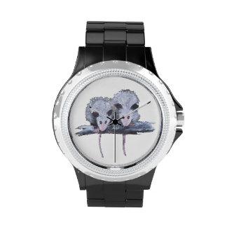 """Reloj de encargo de """"dos oposums"""""""
