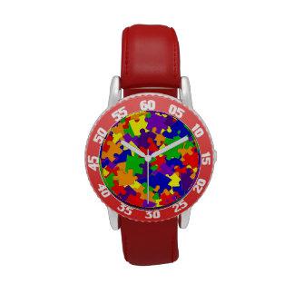Reloj de la conciencia del autismo con los pedazos