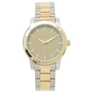 reloj de la Oro-cara