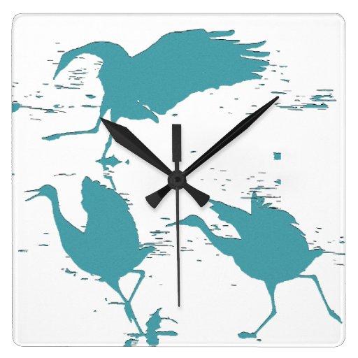 Reloj de los animales de la fauna de los pájaros