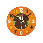 Reloj de pared anaranjado del mono del safari de s