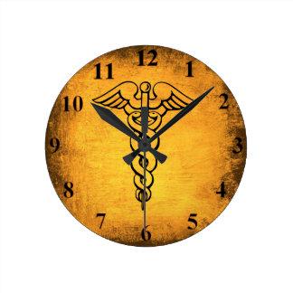 Reloj de pared antiguo del caduceo
