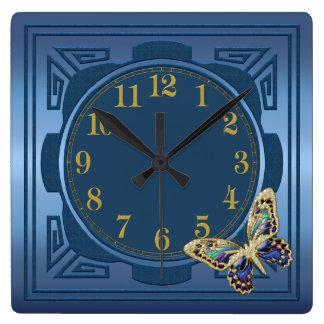 Reloj de pared azul de la mariposa
