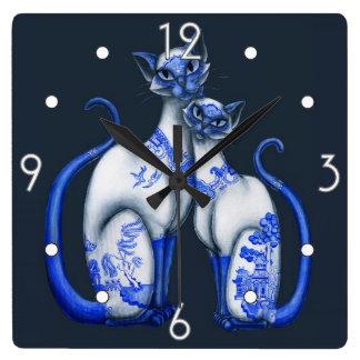 Reloj de pared azul de los gatos siameses del sauc