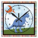 Reloj de pared azul del dinosaurio del niño