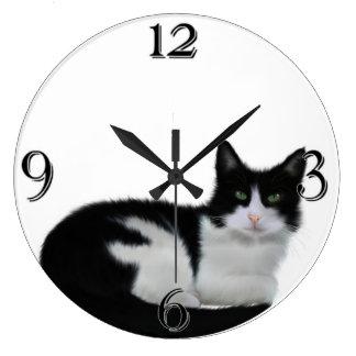 Reloj de pared blanco y negro lindo del gato