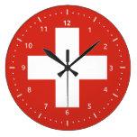 Reloj de pared con la bandera de Suiza