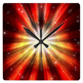 Reloj de pared cósmico de la explosión del fuego