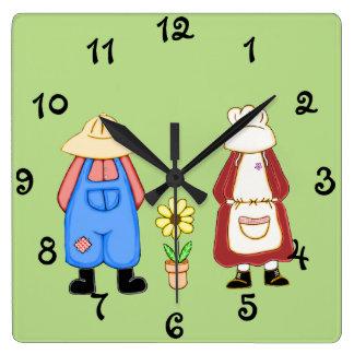 Reloj de pared cuadrado del chico del campo y del