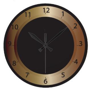 Reloj de pared de bronce y negro