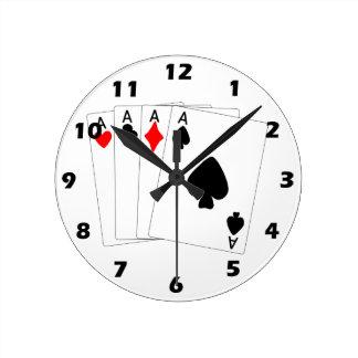 Reloj de pared de cuatro as