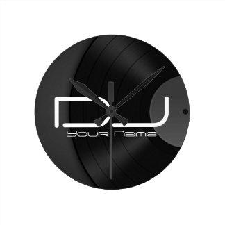 Reloj de pared de DJ con el fondo del vinilo