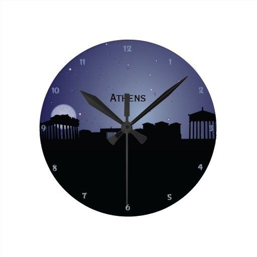 Reloj de pared de la silueta de la noche del paisa