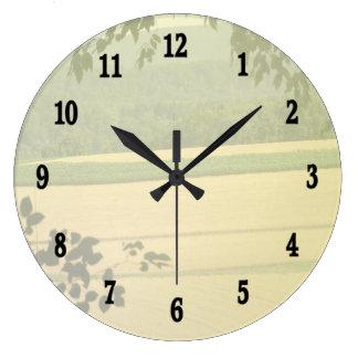 Reloj de pared de la tierra del país