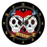 Reloj de pared de los cráneos del amor