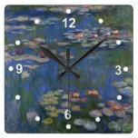 Reloj de pared de los lirios de agua de Monet