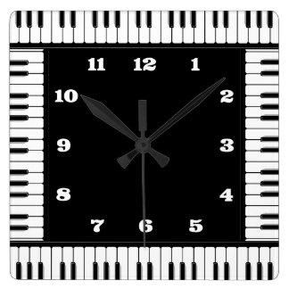 Reloj de pared decorativo del piano blanco y negro