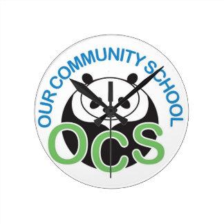 Reloj de pared del logotipo de OCS