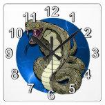 Reloj de pared del relámpago de la cobra