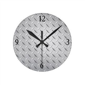 Reloj de pared en la placa de plata del diamante