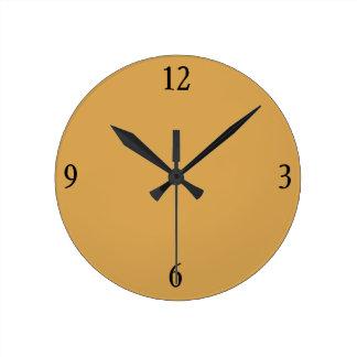 Reloj de pared en oro