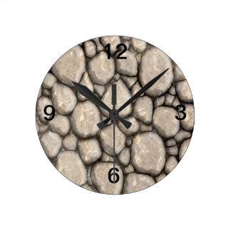 Reloj de pared en piedra