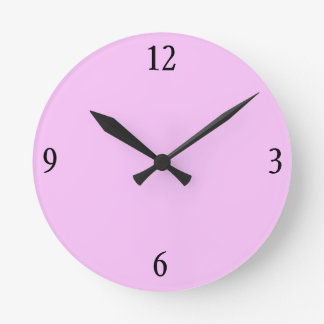 Reloj de pared en rosa