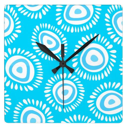 Reloj de pared enrrollado azul precioso de las flo