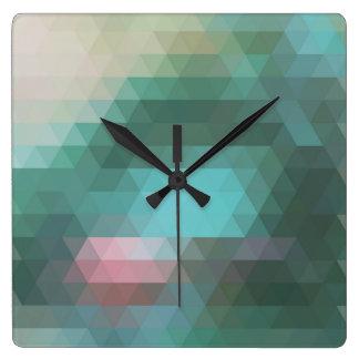 Reloj de pared geométrico abstracto del triángulo