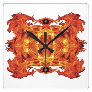 Reloj de pared geométrico travieso de las llamas