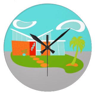 Reloj de pared moderno de la casa del dibujo