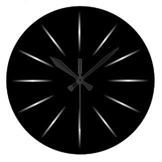 Reloj de pared negro y de plata minimalista