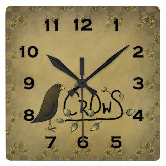 Reloj de pared primitivo del cuervo del país