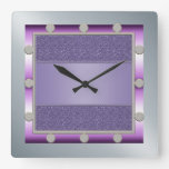 Reloj de pared púrpura y de plata