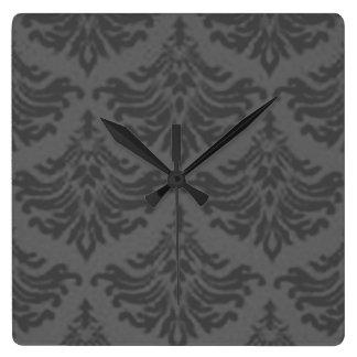Reloj de pared retro del gris de carbón de leña de