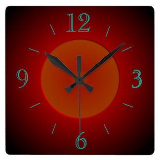 Reloj de pared rojo/anaranjado atmosférico de