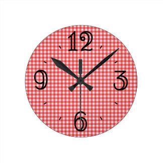 Reloj de pared rojo de la guinga
